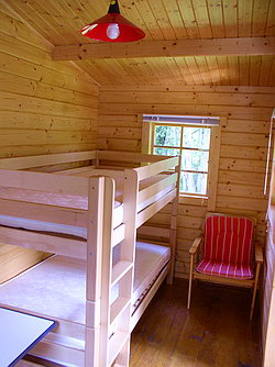 Bunk bed in log cabin 1